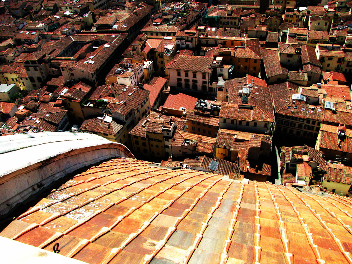 terracotta roofs and cobblestone roads visit tuscany