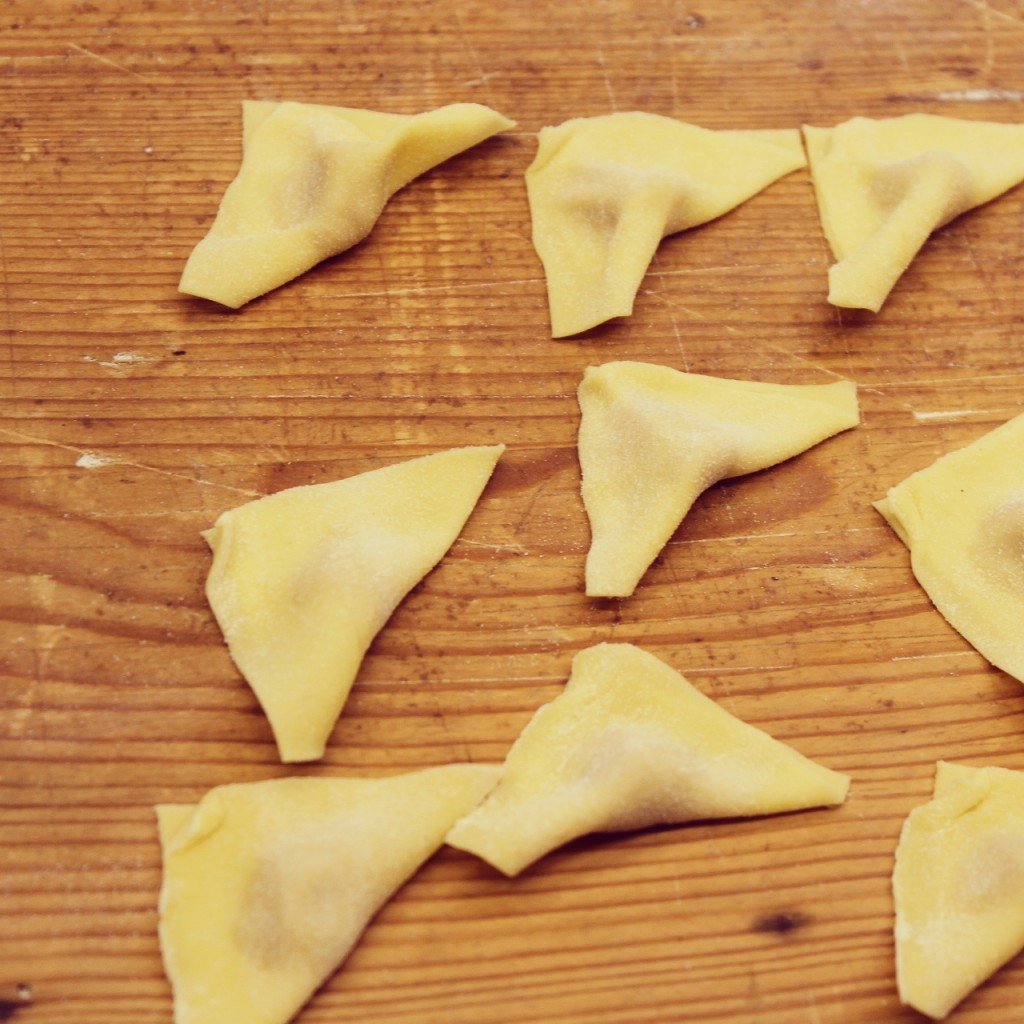 Fold the squares of pasta over the filling to obtain little triangles,
